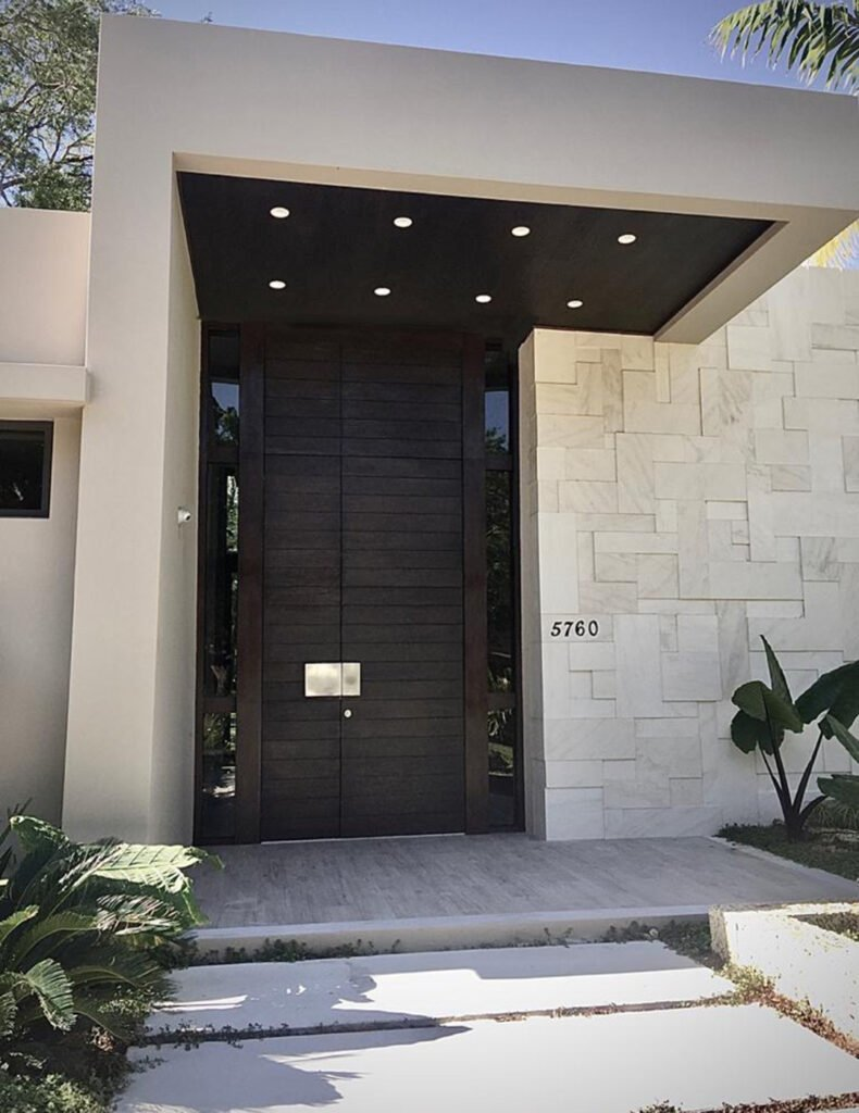Oversized pivot door custom-made for a client's newly-built property